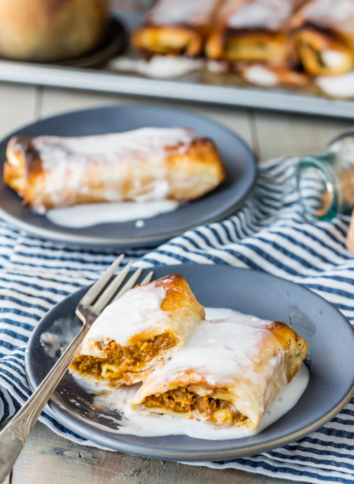 Baked Pumpkin Pie Chimichangas! Tortillas stuffed with pumpkin pie, topped with icing or whipped cream...THESE ARE AMAZING! The BEST dessert for Thanksgiving!