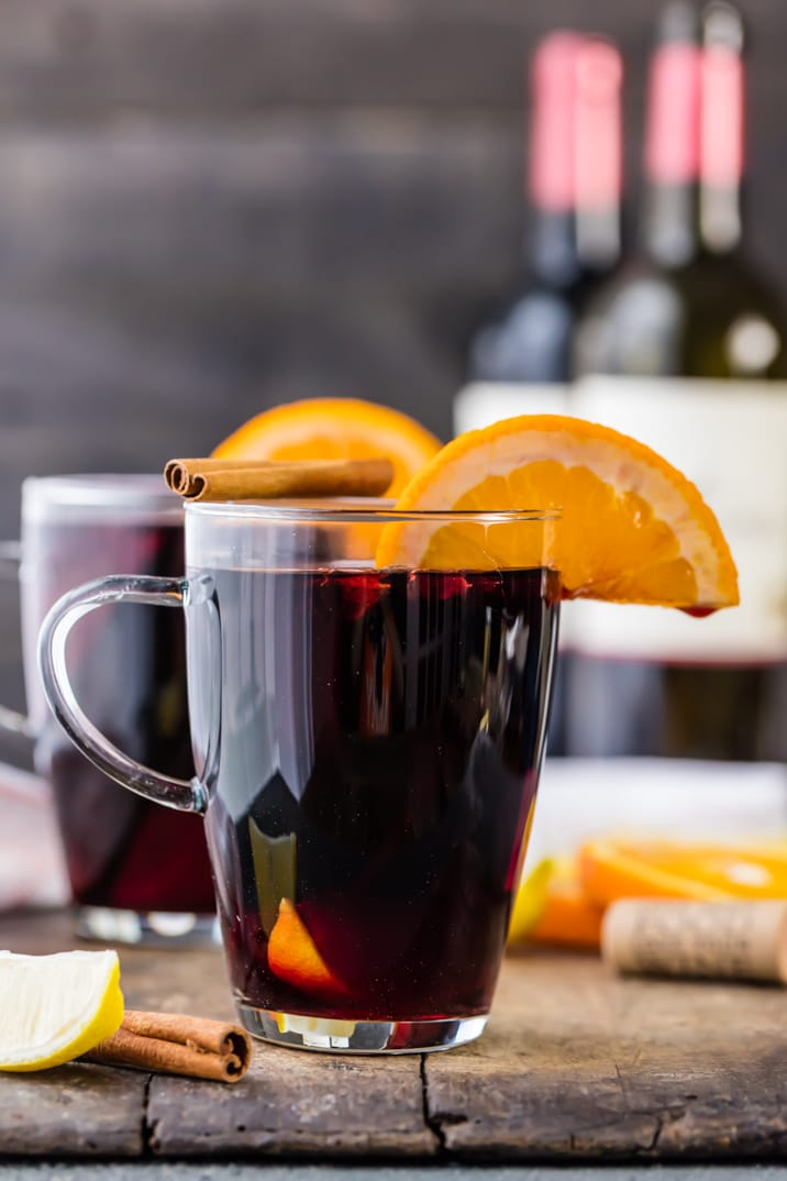 Glass of spiced wine with an orange slice and cinnamon stick sitting on top