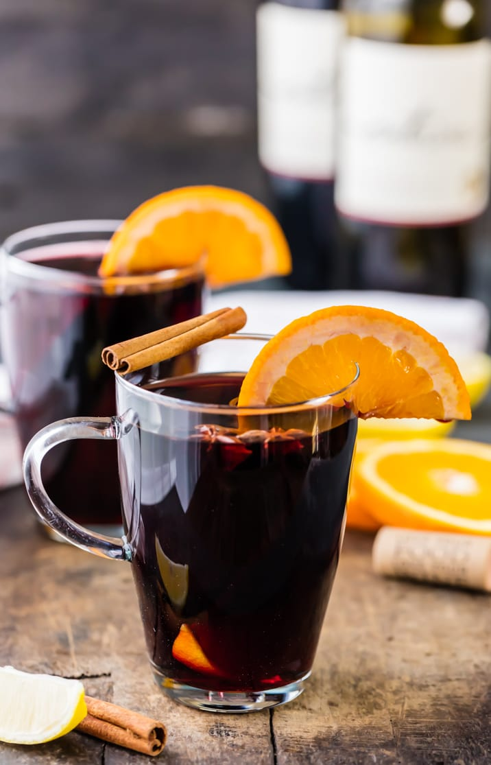 Holiday Spiced Wine, garnished with cinnamon and oranges