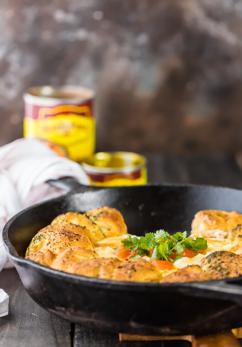 skillet bean and cheese dip with pull apart bread in black skillet