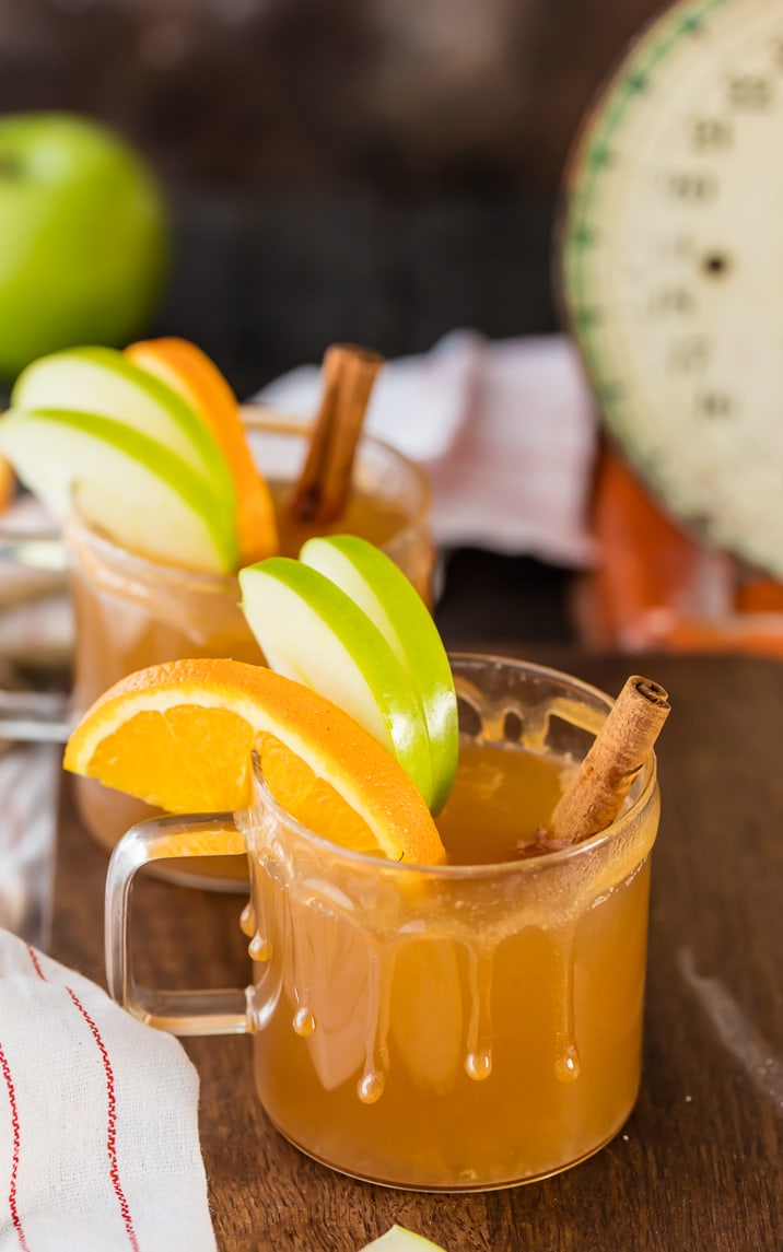 Caramel Apple Cider garnished with apple slices and cinnamon sticks