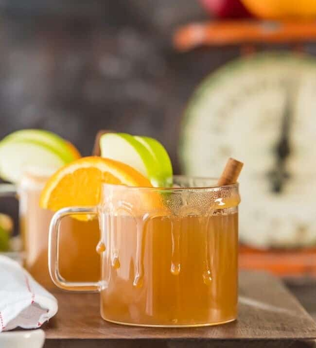 Crockpot Apple Cider is the easiest way to make delicious apple cider from scratch! Even better, this recipe is skinny, low calorie version. This Caramel Apple Cider is the BEST drink recipe for fall. Make it a cocktail or mocktail, both are DELISH. I crave this comforting sip all year round!