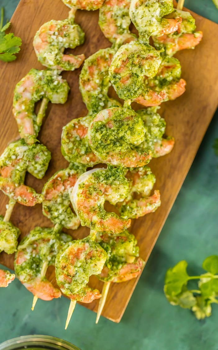 stacks of Pesto Shrimp skewers on a wooden board