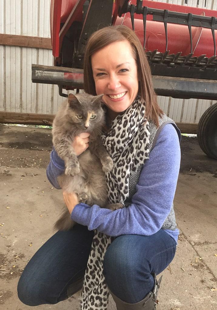 blogger Becky Hardin holds an adorable farm cat