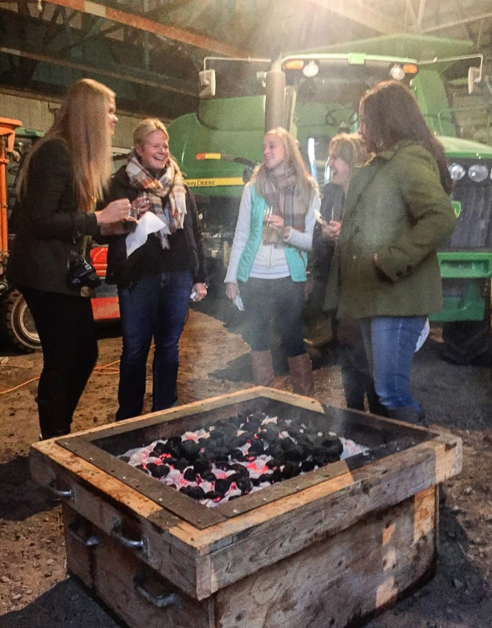 Food bloggers at CornQuest 2015 chat around a fire pit