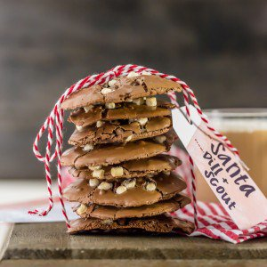 a stack of flourless hot chocolate cookies tied up with red and white stripped string