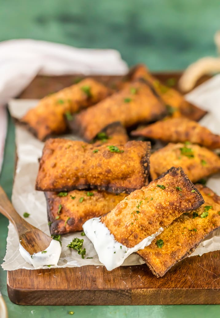 Mini Fried Taco Pizza Pockets...such a fun and simple appetizer or after school snack. ADDICTING! Fried Wontons stuffed with spicy beef, tomatoes, and cheese. These Taco Pizza Rolls are a favorite easy recipe!