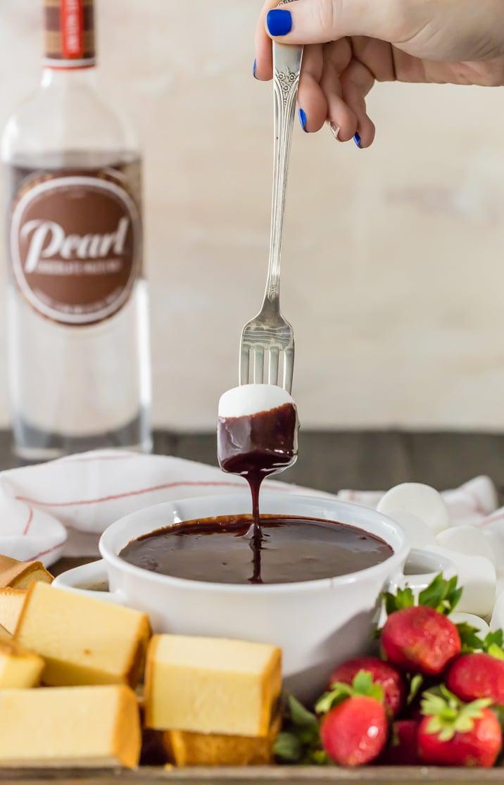 chocolate hazelnut fondue with marshmallow on a fork