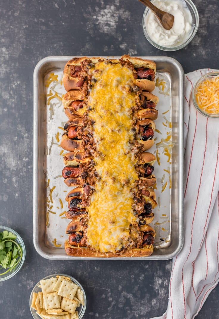 chili cheese dogs on a baking sheet