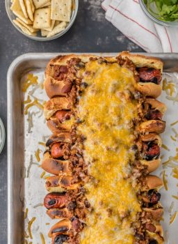 This Chili Dog Recipe all baked together on a sheet pan is the BEST Chili Dog Recipe ever!These Chili Cheese Dogs topped with the best hot dog chili recipe. If you're in the mood for comfort food; toasted buns, grilled hot dogs, best ever chili, and of course tons of cheese; this recipe is for you!