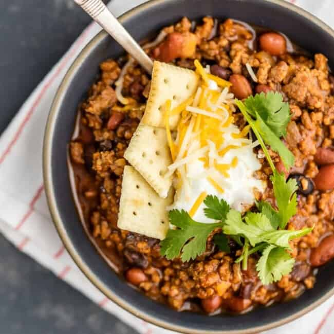 This Best Chili Recipe has been in our family for years. I've had a lot of chili in my life, from white chicken chili to vegetarian chili, and this is hand's down the BEST CHILI I have ever tasted. Two types of meat, lots of beans, and loaded with cheese, sour cream, crackers, and more! You will want to eat this Best Easy Chili Recipe year round, not just the cold months.