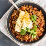 This BEST EVER CHILI RECIPE has been in our family for years. It is SO easy and delicious. A MUST MAKE recipe for every family! Two types of meat, beans, and all the fixings!