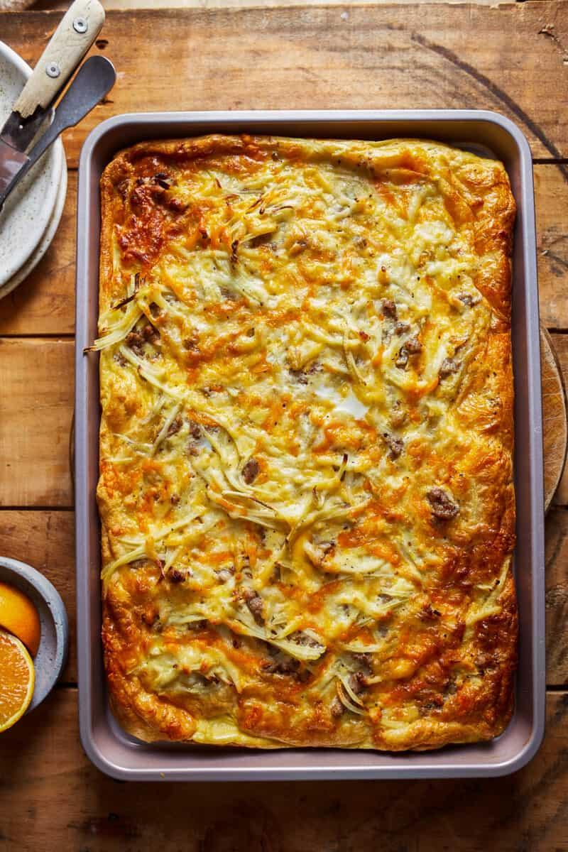sheet pan breakfast pizza on table