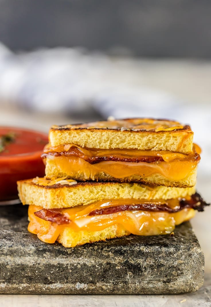 Candied Whiskey Bacon Grilled Cheese Dippers are the PERFECT appetizer recipe for New Years Eve. Sweet and Spicy and cheesy and EASY! BEST grilled cheese recipe ever!