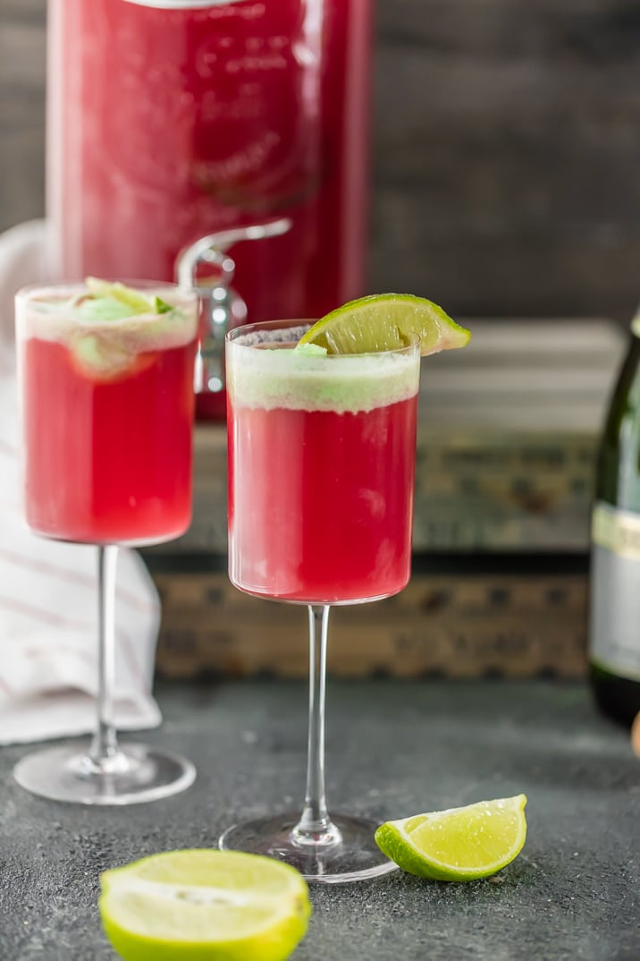Cranberry Limeade Champagne Punch, perfect for Christmas and New Years Eve! Easy punch recipe perfect for a crowd! Champagne Punch topped with Lime Sherbet!