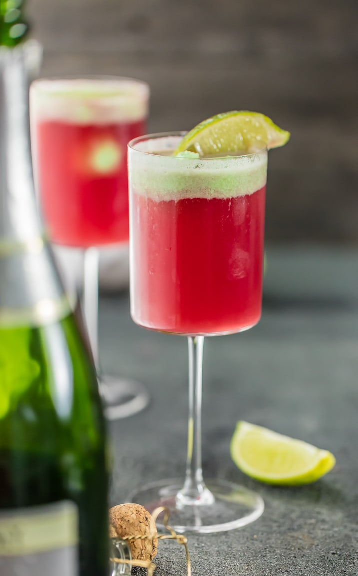 Cranberry Limeade Holiday Champagne Punch, perfect for Christmas and New Years Eve! Easy punch recipe perfect for a crowd! Champagne Punch topped with Lime Sherbet!