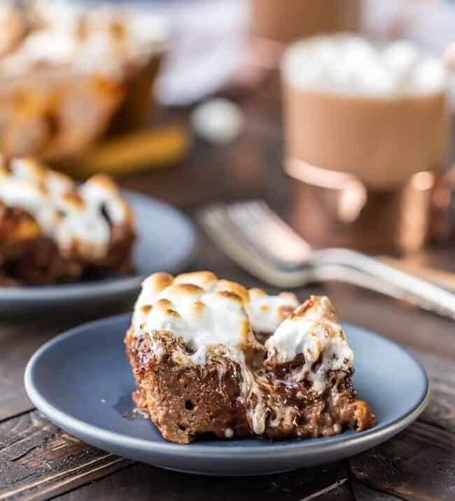 Hot Chocolate Bread Pudding is the perfect holiday recipe. It's like drinking a cup of hot chocolate, but BETTER! An ooey, gooey, decadent chocolate dessert topped with toasted marshmallows. Yum! This dessert (or breakfast) is way too easy to be this delicious!