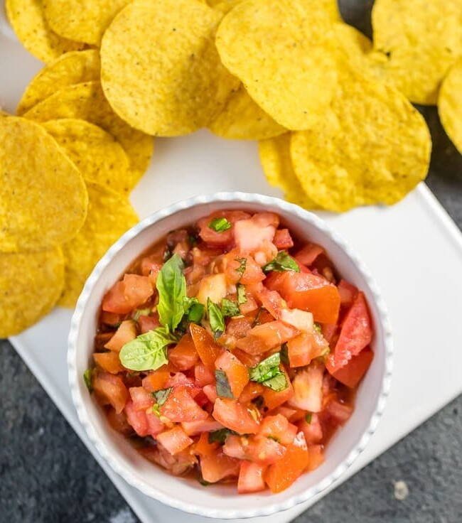 This EASY Italian Salsa only has 5 ingredients! Love these flavors as a dip or bruschetta topper. Simple to throw together and gone in minutes! Favorite easy salsa recipe!