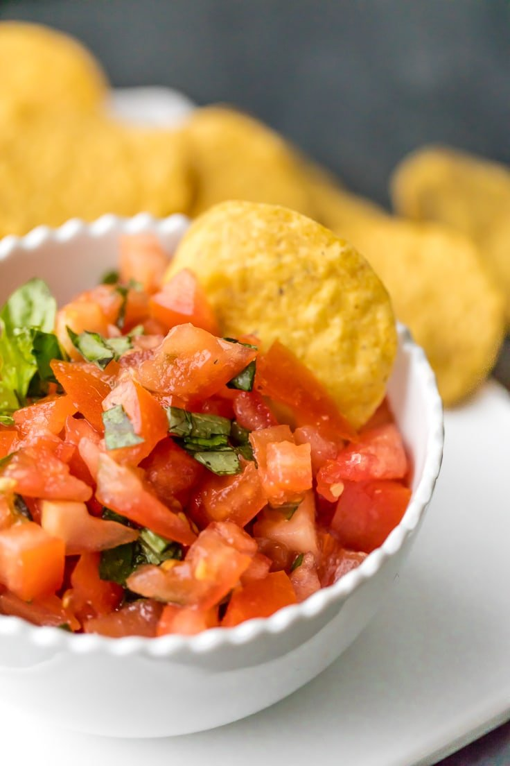 Italian salsa with chip dipped into it.