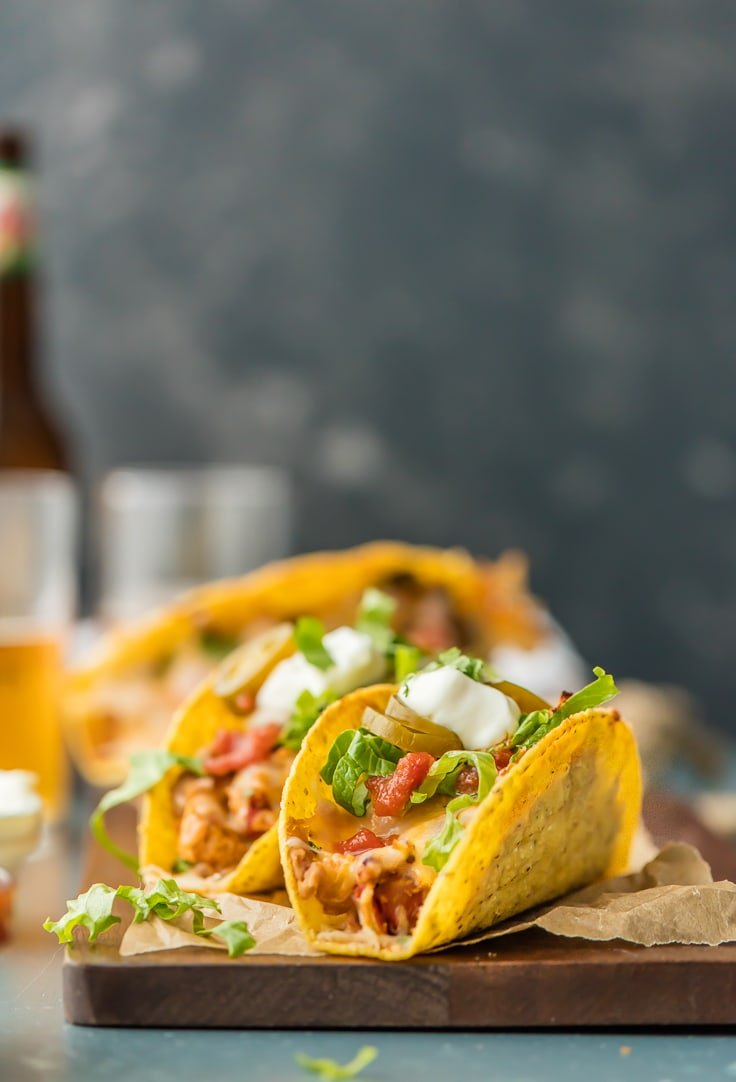 tacos stuffed with toppings and ingredients