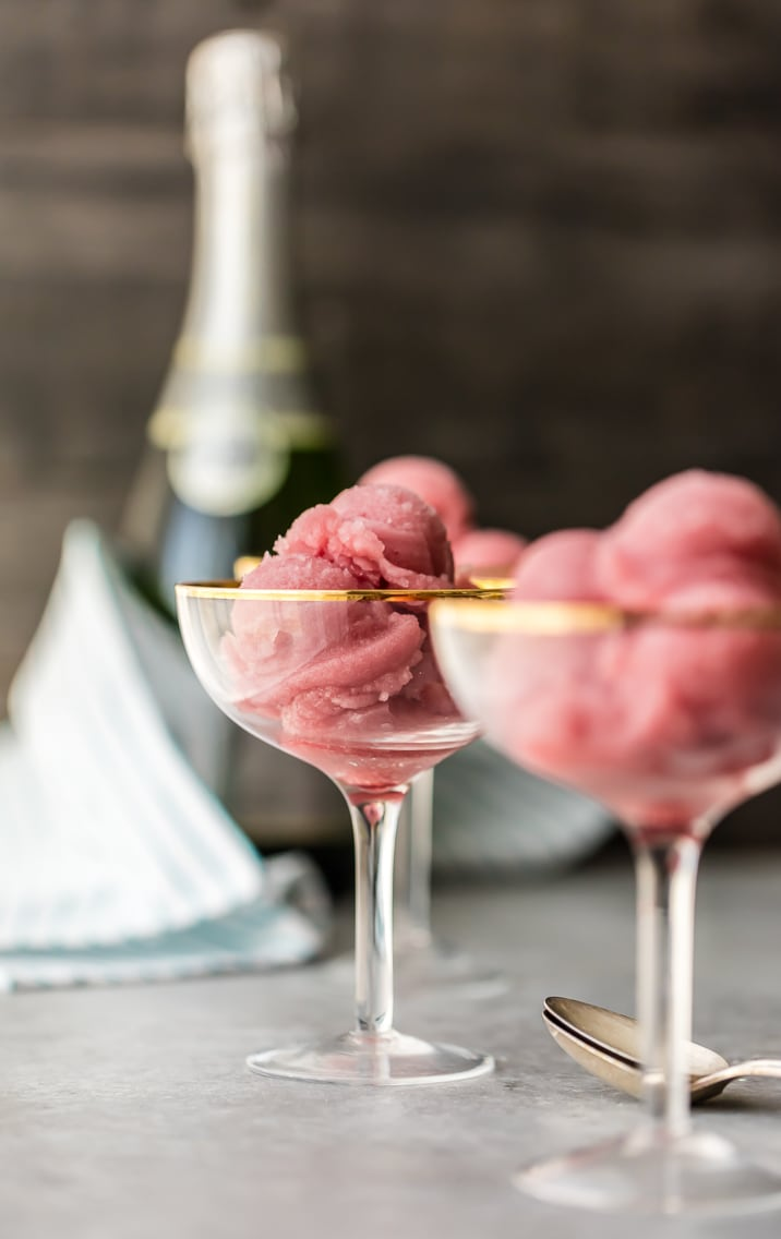 3 glasses of champagne sorbet with a bottle of champagne in the background