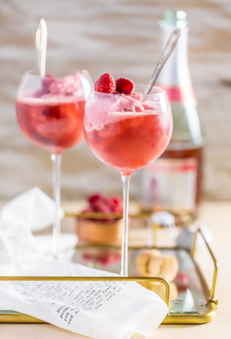 two glasses of raspberry champagne floats