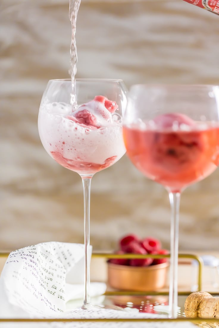 two pink champagne floats in wine glasses