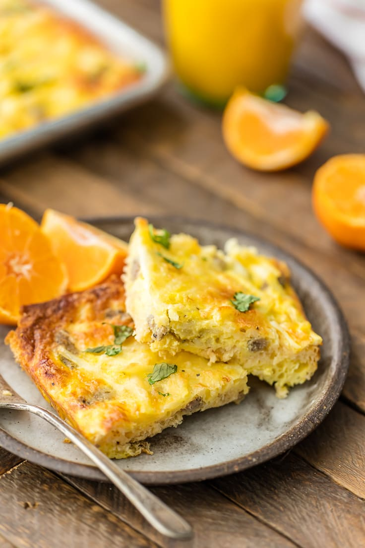 plate of sheet pan breakfast pizza with orange slices