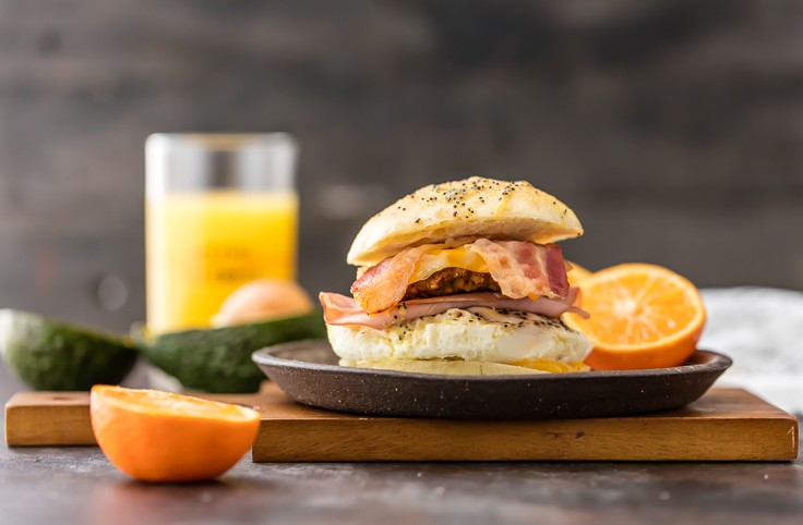 The ULTIMATE Baked Breakfast Sandwich Sliders!!! We always make these for TAILGATING! Easy, delicious, and filling for a day at the game! BEST Make Ahead Baked Breakfast Sandwich recipe!