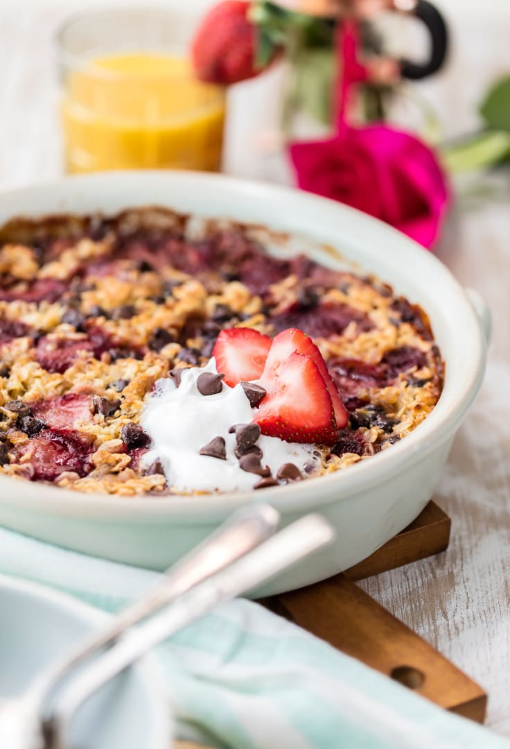chocolate and strawberry baked oatmeal in a large round white dish