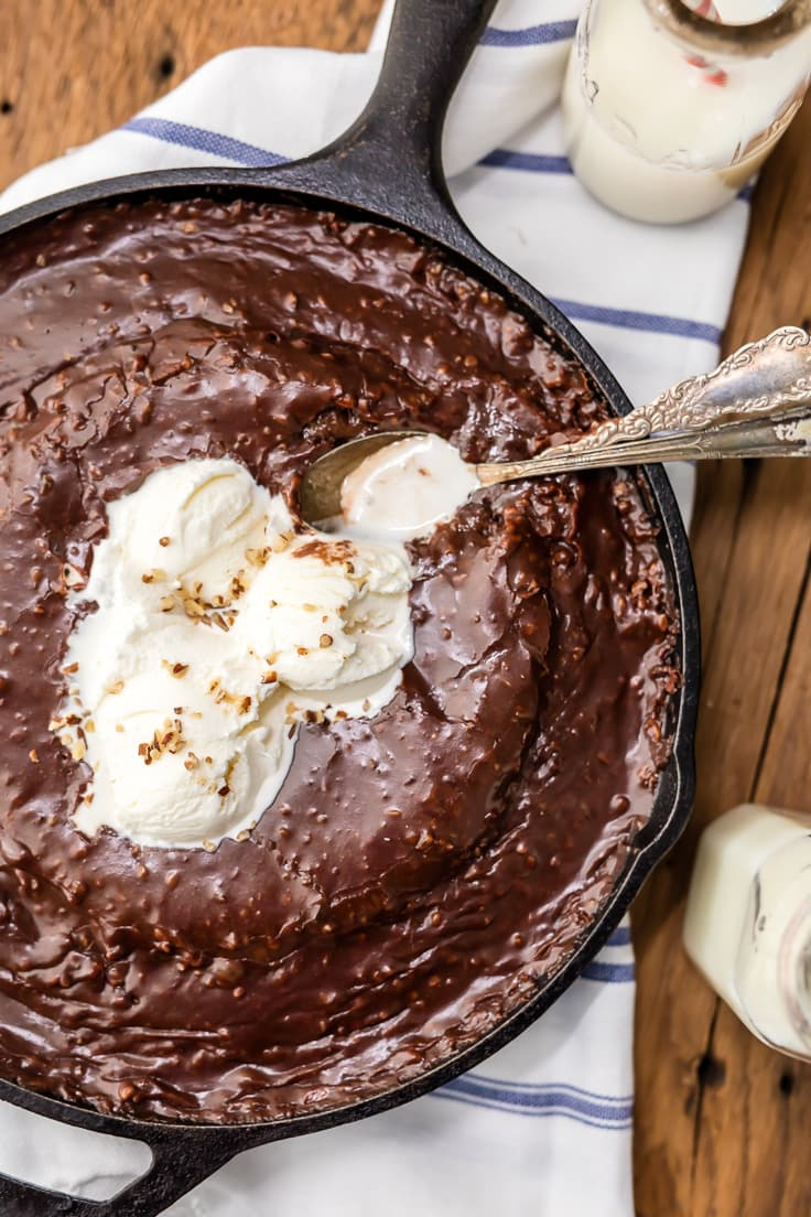 chocolate cake made in a skillet, topped with ice cream