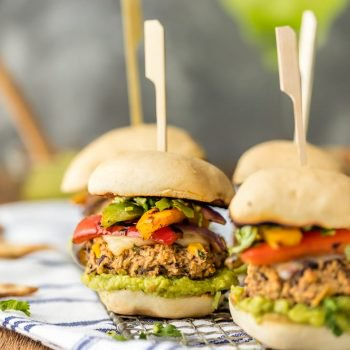 Black Bean Burger Veggie Sliders are a tasty AND healthy option for tailgating. This mini black bean burger recipe is loaded with hummus, guacamole, black beans, and fajita style veggies! It's the best little vegetarian burger ever, and trust me, you won't miss the meat. These are just SO good!