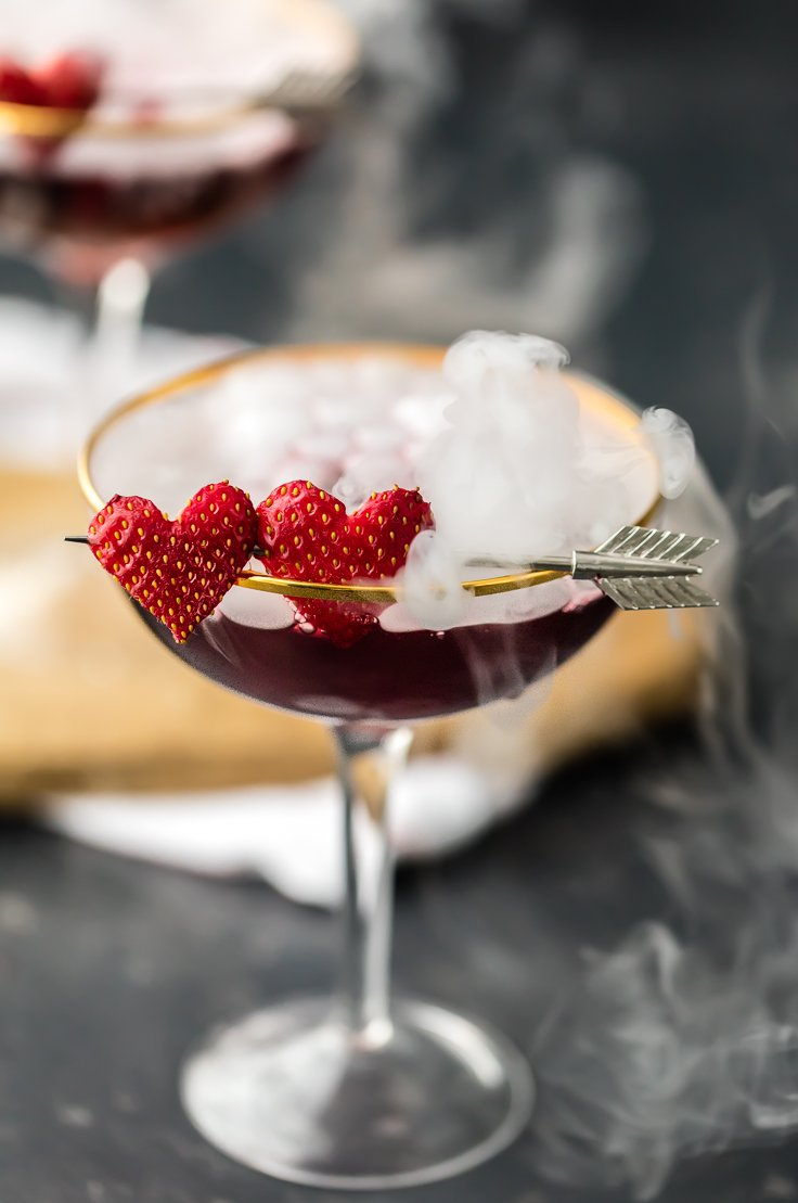 You need LOVE POTION #9 MARTINI for Valentine's Day! This is the cutest Valentine's Day Cocktail! Triple Berry Martini tastes great, is beautiful, and EASY! Made with dry ice, this is such a fun and festive Valentines Day pink drink!