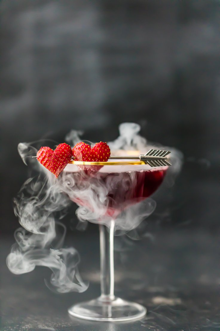 pomegranate martini with dry ice smoking out