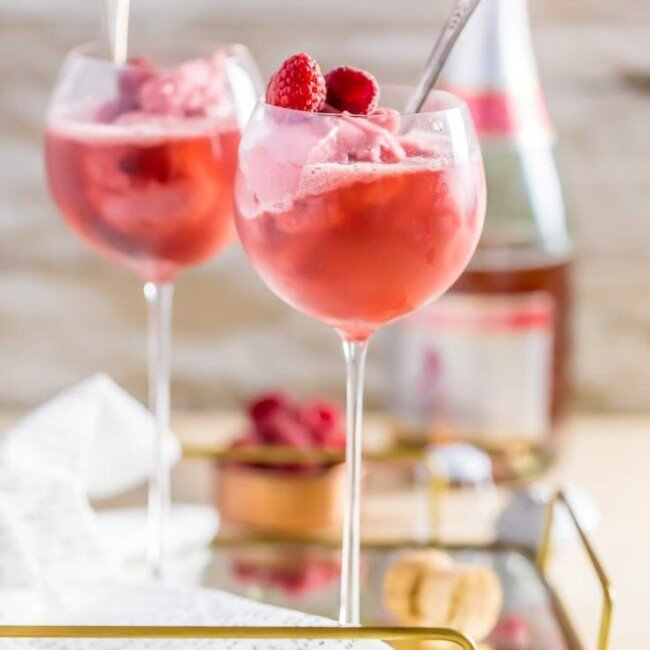 pink champagne floats in wine glasses on a tray