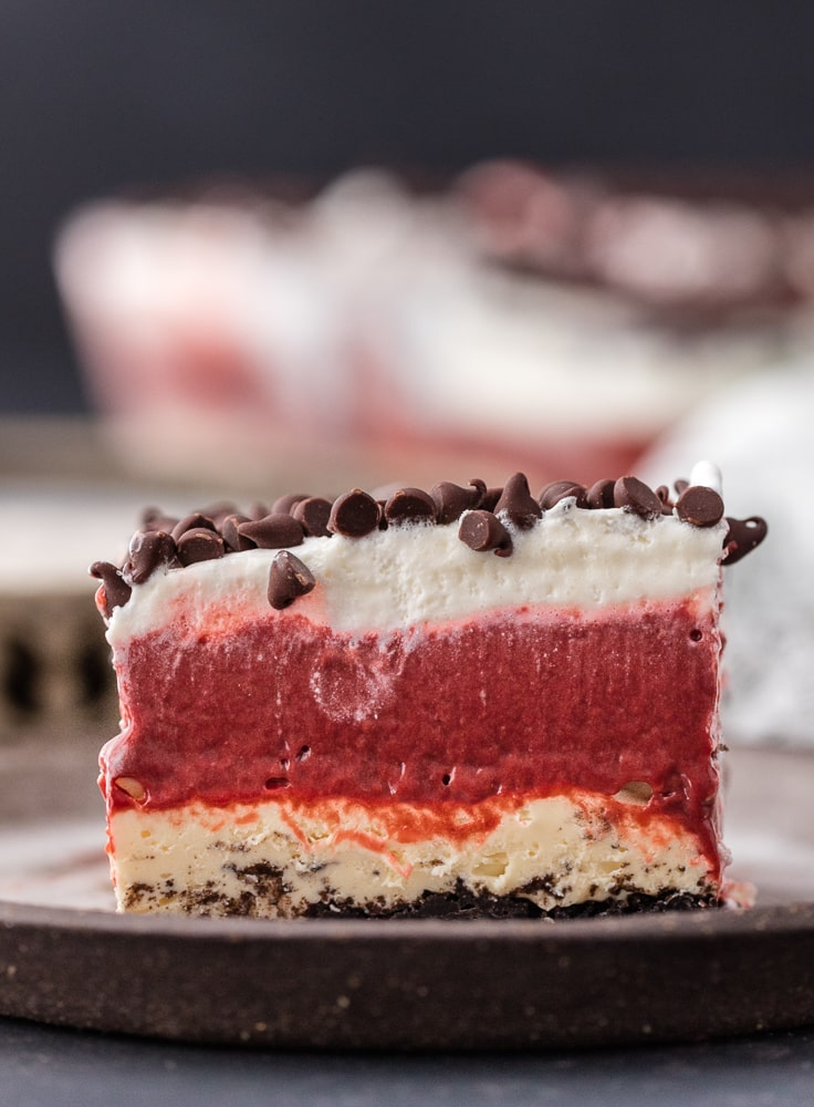a dessert lasagna made from cheesecake, pudding, chocolate chips, and more