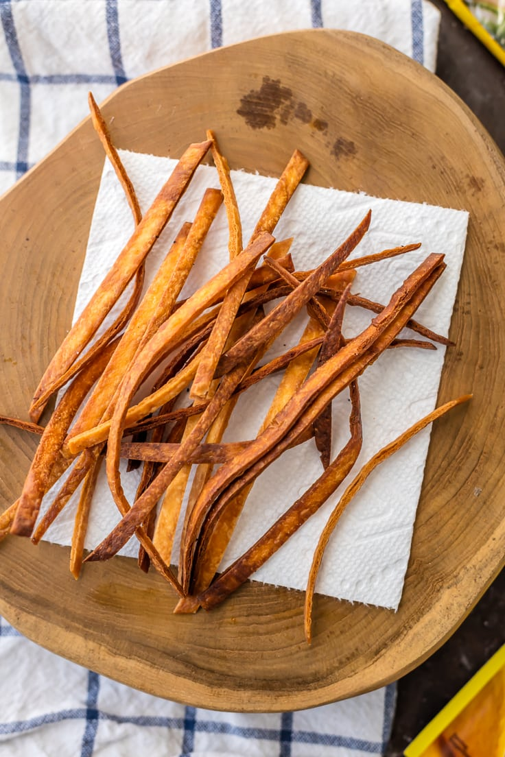 fried tortilla strips on a wood board