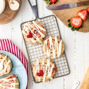 Strawberry Cinnamon Roll Cookies for Valentine's Day! These are such sweet sugar cookies perfect for any occasion, they look just like cinnamon rolls and taste like perfection! Cutest recipe ever!