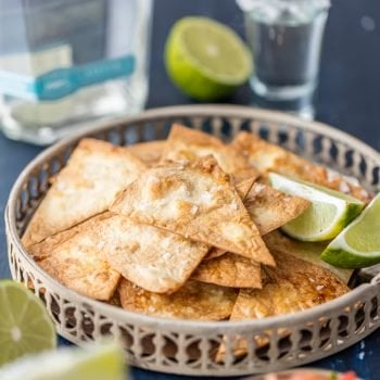 Tequila Lime Tortilla Chips are an easy way to add extra flavor to chips and dip or nachos. These baked tortilla chips are baked instead of fried, and so easy to make. This simple healthy tortilla chips recipe can be made in minutes at home, using soft flour tortillas.