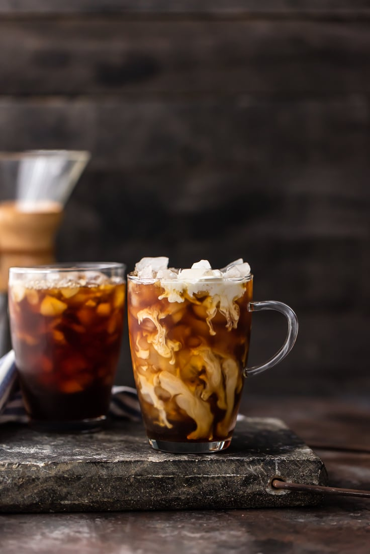 two glass mugs with thai iced coffee