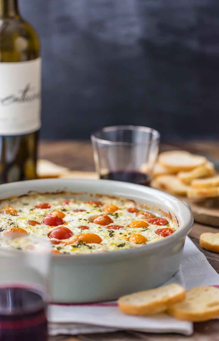 tomato goat cheese dip in a large white serving dish