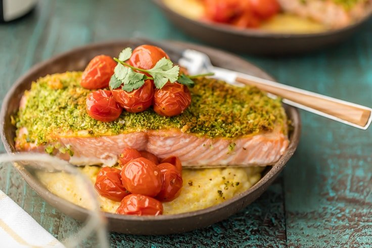 a plate of herb crusted salmon and goat cheese polenta