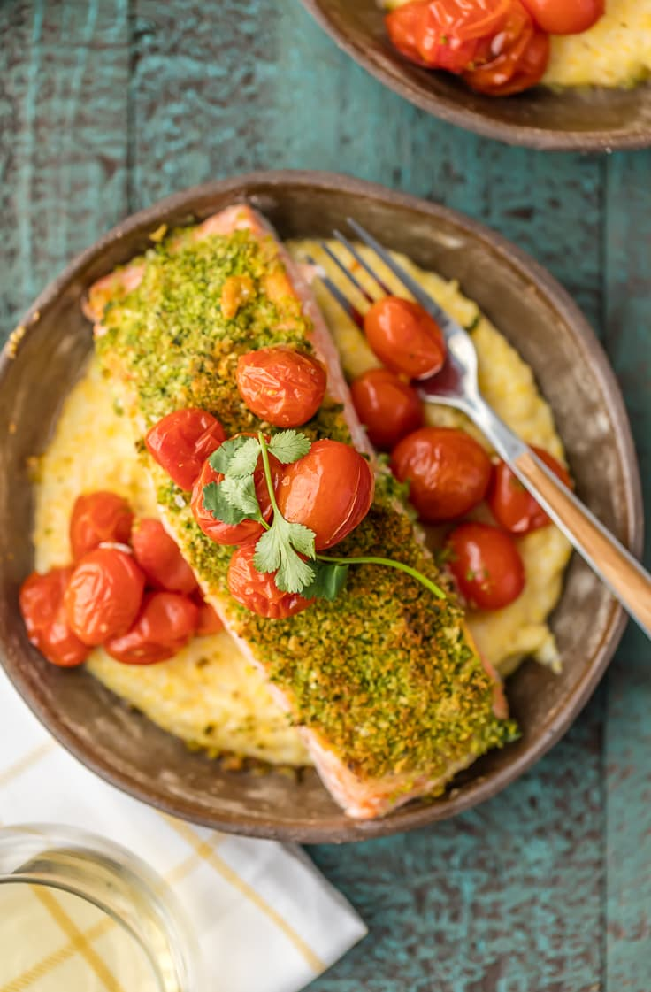 a bowl of goat cheese polenta with herb crusted salmon fillet