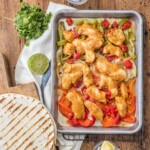 SKINNY BAKED SHEET PAN CHICKEN FAJITAS are our favorite healthy dinner! Such an easy recipe that everyone will love. Made with greek yogurt instead of sour cream! Perfection.