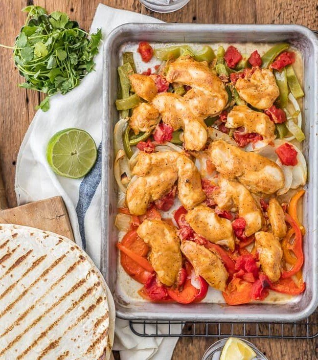Sheet Pan Chicken Fajitas are one of our favorite healthy dinners! These baked chicken fajitas are lighter in calories and fat, but still packed with flavor. These healthy chicken fajitas are an easy sheet pan fajitas recipe that everyone will love. It's the perfect dinner for two!