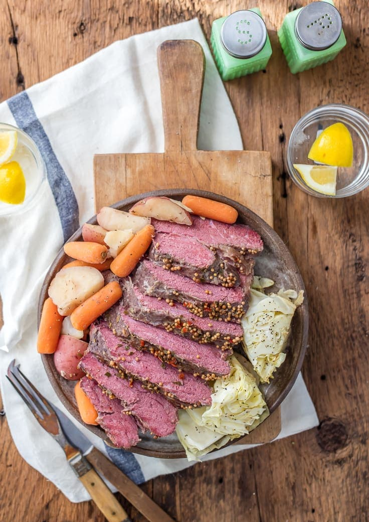 Traditional Slow Cooker Corned Beef and Cabbage is a MUST MAKE easy St. Patrick's Day recipe! Such an fun and easy recipe to celebrate St. Patricks Day! Corned Beef, Cabbage, Potatoes, and Carrots!