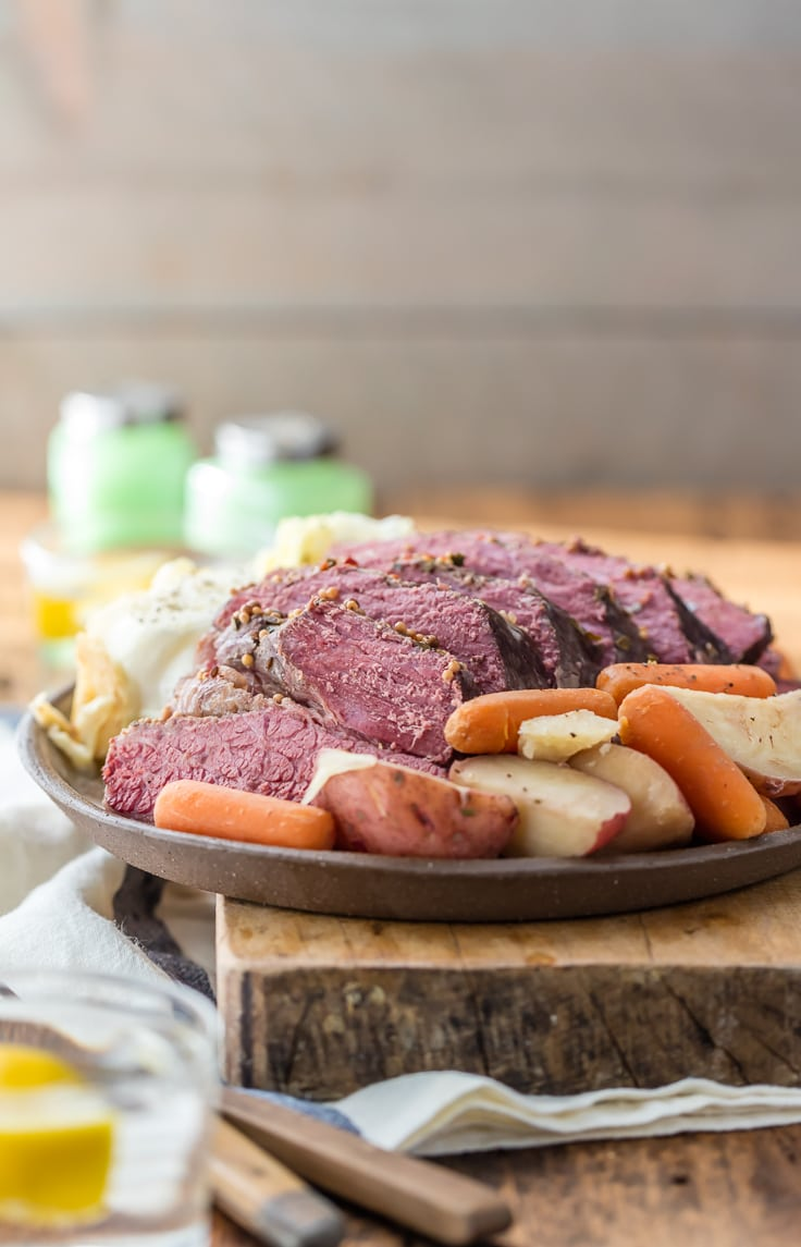 Crock Pot Corned Beef and Cabbage is a MUST MAKE St. Patrick's Day recipe! Slow Cooker Traditional Corned Beef and Cabbage is easy, juicy, tender, and an entire meal in one pot. I can't get enough of those potatoes and carrots in that sauce! My favorite Irish recipe.