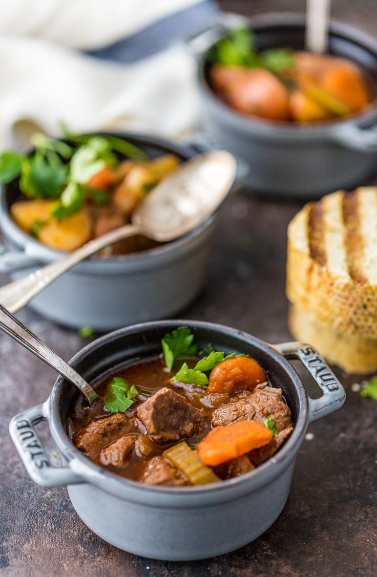Irish stew with beef and carrots in three bowls