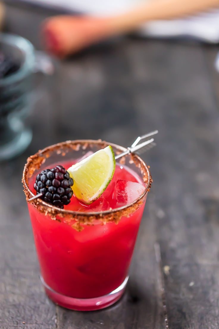margarita garnished with blackberry and lime