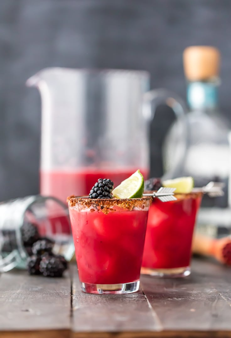 two glasses of spicy blackberry margarita